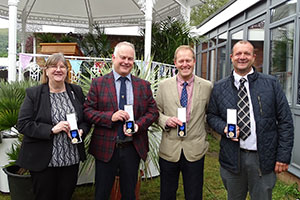 Four staff members from Wyevale Nurseries with their 120 years of service awards