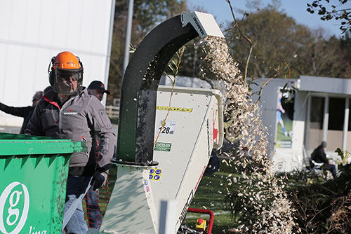 Man chopping wood at SALTEX event