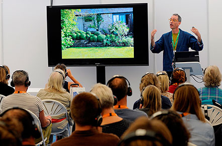 Man talking to crowd at Landscape Event